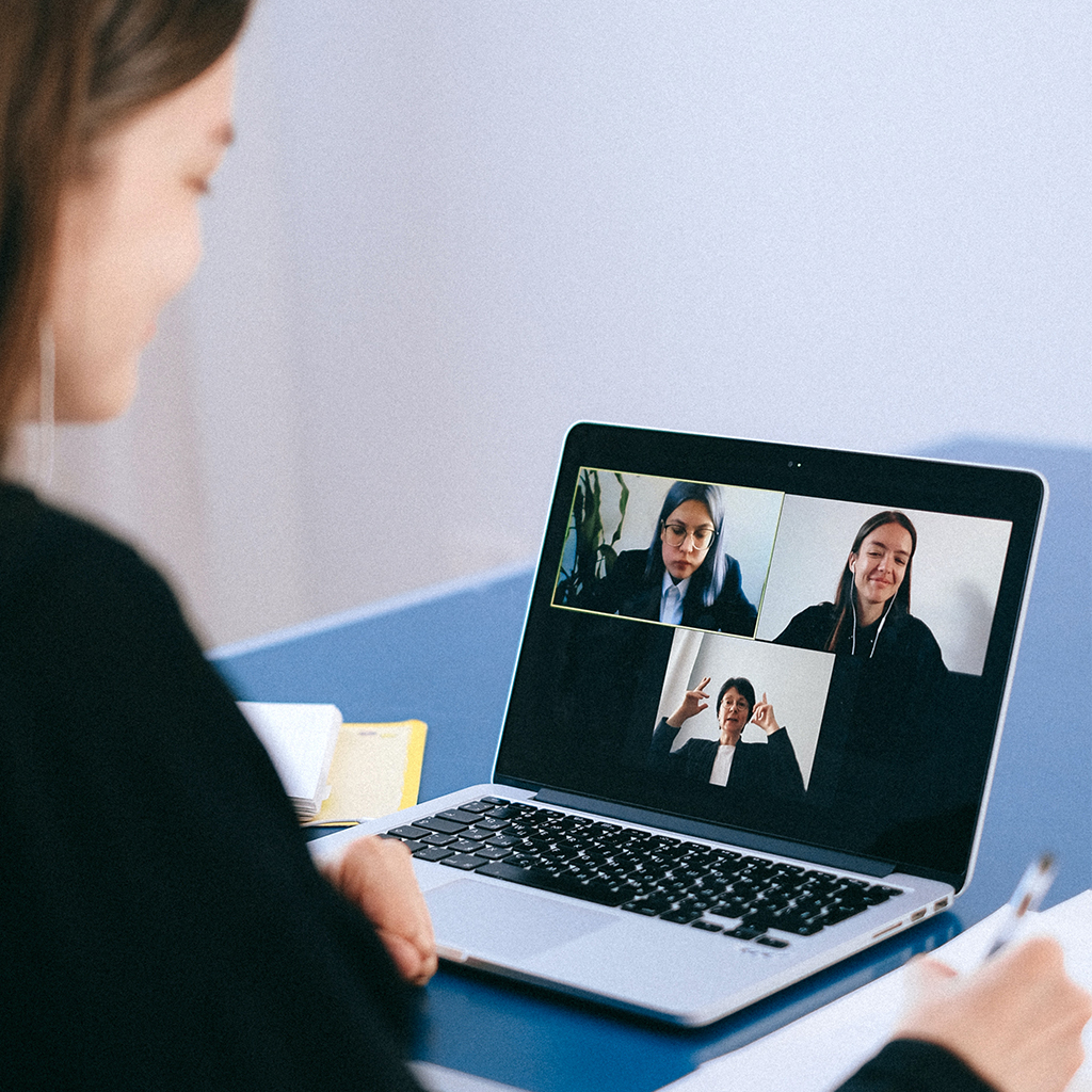 Woman involved with a video meeting